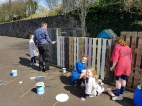 Giving our fence a lick of paint!